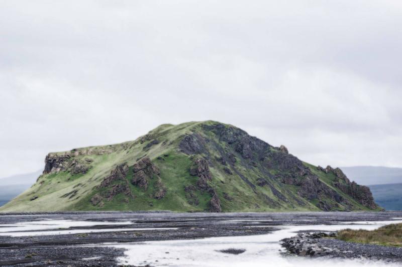 Green rocky hill